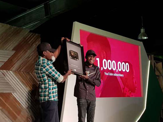 Mark Angle receiving plaque for reaching 1 million subscribers on YouTube